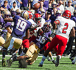 Washington Huskies kickoff coverage team jars the ball loose from Eastern Washington Eagles' Mario Brown (5) at Husky Stadium September 6, 2014 in Seattle. Huskies out lasted the Eagles in a high powered shootout 59-52 in the third highest scoring game in Husky history. ©2014. Jim Bryant  Photo. All Rights Reserved