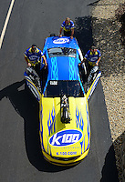 Sept. 28, 2012; Madison, IL, USA: NHRA crew members push the car of pro mod driver Mike Janis during qualifying for the Midwest Nationals at Gateway Motorsports Park. Mandatory Credit: Mark J. Rebilas-