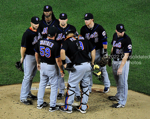 New York Mets pitcher Dillon Gee (35) is surrounded by teammates to settle him down in  the sixth inning against the Washington Nationals at Nationals Park in Washington, D.C. on Friday, July 29, 2011.  The Mets won the game 8 - 5..Credit: Ron Sachs / CNP.(RESTRICTION: NO New York or New Jersey Newspapers or newspapers within a 75 mile radius of New York City)