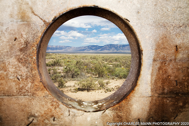 The Trinity Test Site, where the first atomic bomb was exploded on July 16, 1945, is open to the  public on the first Saturday in April and October. Looking out the view port at West 10,000 Bunker. Ground Zero is the  light horizontal patch inthe green vegetation at center.