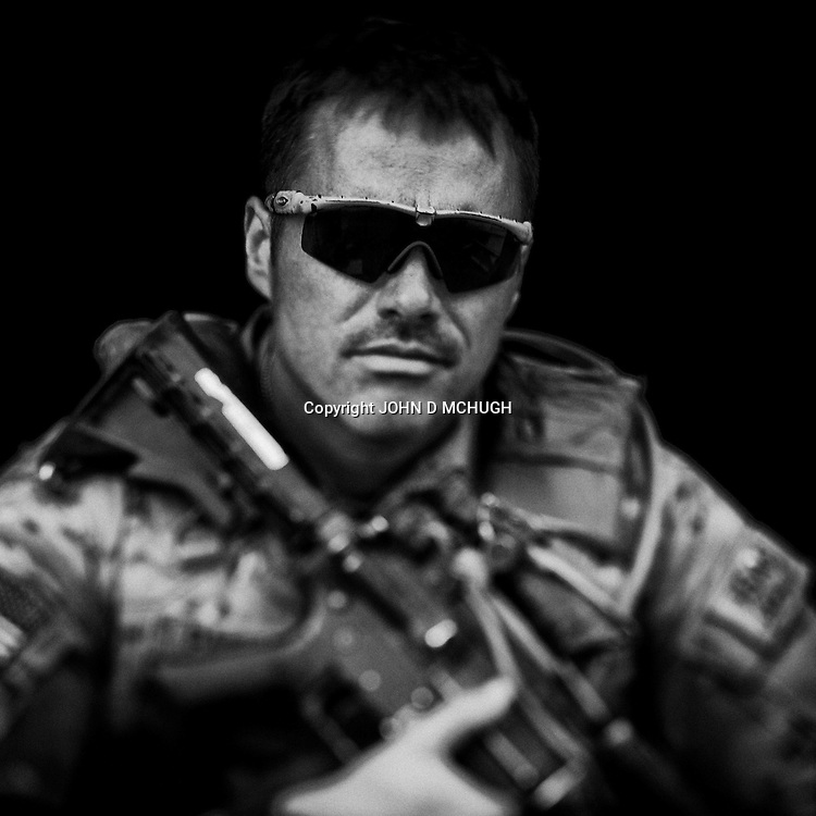 SFC Pakulak of 1 Platoon, Delta Co, 1-66, 4th Infantry Division, is seen at Combat Outpost TJ in the Arghandab Valley, 04 May 2011. (John D McHugh)