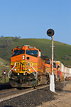 A BNSF intermodal train descends California's Tehachapi Mountains.