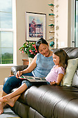 Grandmother spending time with grand daughter on couch