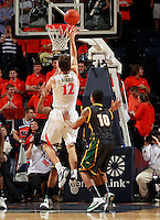 CHARLOTTESVILLE, VA- DECEMBER 6: Joe Harris #12 of the Virginia Cavaliers shoots in front of Sherrod Wright #10 of the George Mason Patriots during the game on December 6, 2011 at the John Paul Jones Arena in Charlottesville, Virginia. Virginia defeated George Mason 68-48. (Photo by Andrew Shurtleff/Getty Images) *** Local Caption *** Joe Harris;Sherrod Wright