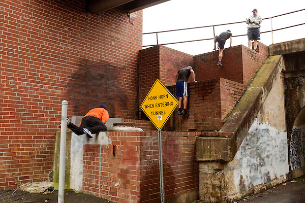 December 22, 2014. Lexington, North Carolina.<br /> Mayor Newell Clark, 2nd from right, leads his exercise group on a climb up the side of a railroad bridge as part of their workout routine incorporating local infrastructure.<br />   Newell Clark, the 43 year old mayor of Lexington, NC, leads a group of friends and colleagues on a 4 times a week exercise routine around downtown. The group uses existing infrastructure, such as an abandoned furniture factory, loading docks, stairs, and handrails to get fit and increase awareness of healthy lifestyles in a town more known for BBQ.<br /> Jeremy M. Lange for the Wall Street Journal<br /> Workout_Clark