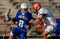 Ryan Nizolek (24) of Virginia checks Max Quinzani (8) of Duke during the ACC men's lacrosse tournament semifinals in College Park, MD.  Virginia defeated Duke, 16-12.