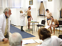 Young Polish mean have their medical exams, required before the army draft. This year's draft may be the last one as the Polish army is turning professional...........