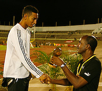 Ierahin Zayes accepting his award from Donald Quarrie at the Jamaica International Invitational Meet held in Kingston, Jamaica on May 2nd. 2009. Photo by Errol Anderson,The Sporting Image.net