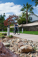 A cyclists rides down the new class I bike path along Harbor Blvd. in Costa Mesa.  Note: Clouds have a little less detail in them than I'd like.