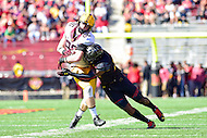College Park, MD - OCT 15, 2016: Minnesota Golden Gophers tight end Brandon Lingen (86) is hit hard by Maryland Terrapins defensive back Alvin Hill (27) during game between Maryland and Minnesota at Capital One Field at Maryland Stadium in College Park, MD. (Photo by Phil Peters/Media Images International)