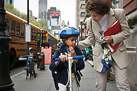 Marilyn Berger (R), widow of Don Hewitt, talks to Danny Hodes, the 8 year-old Ethiopian she has taken in, on the way back from school in New York, NY, USA, 9 April 2010. Ms Berger met him in Addis Ababa while reporting there and helped him get surgery.