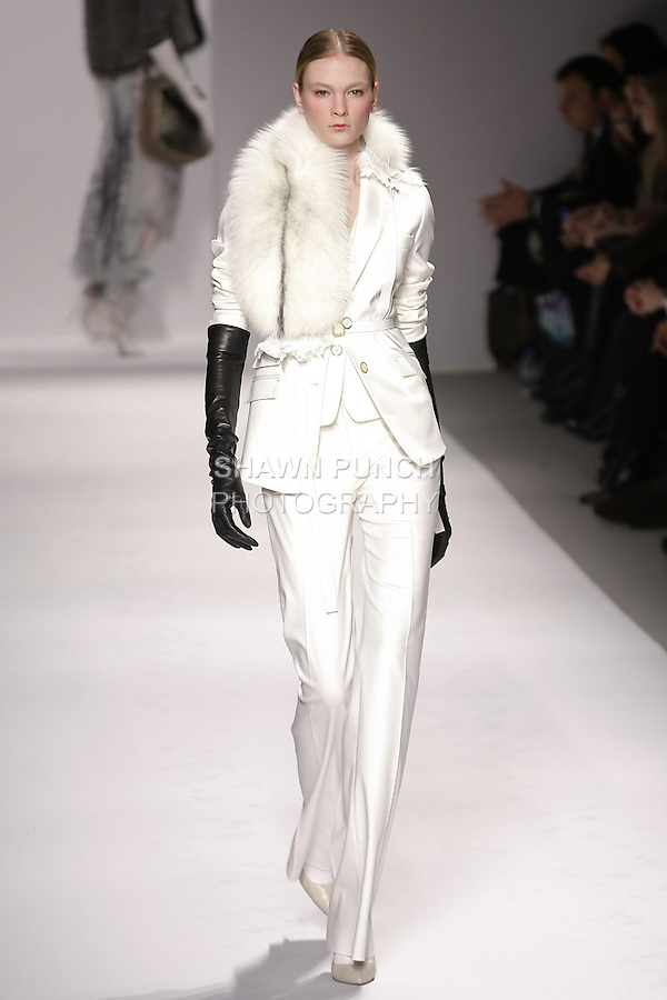 Irina Kulikova walks runway in an outfit from the Elie Tahari Fall 2011 collection, during Mercedes-Benz Fashion Week Fall 2011.