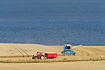 Combine harvester in field against the River Tay