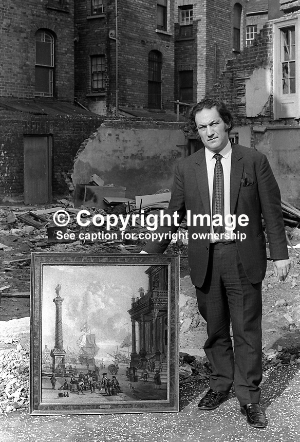 Leonard Kaitcer with a painting he salvaged from Provisional IRA bomb attack on his Belfast N Ireland antiques shop on 26th January 1972. Mr Kaitcer was kidnapped over two years later. His body was found on the Glen Road, Andersonstown. Although no organisation admitted responsibility it was assumed that a republican organisation was involved because of where the body was found. 197201260034b<br />