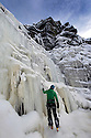 """22/01/13..Stephan Morris, begins his climb...After many days below zero a giant waterfall has now frozen solid attracting climbers to tackle the huge 30 metre ascent up the freshly formed icicles and towers of ice. Known as Kinder Downfall the waterfall is the tallest in the Peak District. The river Kinder cascades over the top of the Kinder Scout plateau near the Pennine Way 2,087 ft above sea level mid-way between the villages of Hayfield and Edale in the High Peak of Derbyshire...Finding out when the waterfall is ready to climb is shrouded in secrecy. One of the six climbers who scaled the frozen spectacle today said: """"There's lots of misinformation on the internet, everyone wants to be the first to climb it as soon as it's in condition to climb""""...The climb up to the face of the waterfall took many hours today with climbers trudging through waist-deep snow-drifts before strapping on their crampons and using ice axes to scale the Downfall...All Rights Reserved - F Stop Press.  www.fstoppress.com. Tel: +44 (0)1335 300098."""