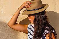 A Colombian woman wearing a fedora, Akumal, Riviera Maya, Mexico.