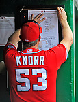 20 May 2012: Washington Nationals bench coach Randy Knorr pins up the lineup for a game against the Baltimore Orioles at Nationals Park in Washington, DC. The Nationals defeated the Orioles 9-3 to salvage the third game of their 3-game series. Mandatory Credit: Ed Wolfstein Photo