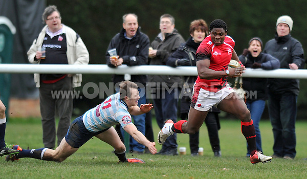 Joe Ajuwa breaks clear. British and Irish Cup match, between London Welsh and Edinburgh Academical on December 7, 2013 at Old Deer Park in London, England. Photo by: Patrick Khachfe / Onside Images
