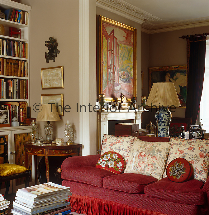 View from the drawing room that opens into the dining room where an interior by Roy de Maistre hangs over the fireplace