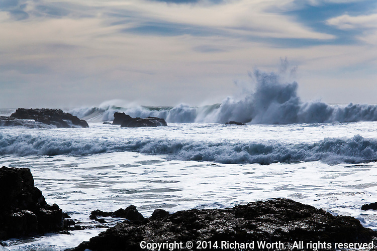 Roaring waves climb then crash.  Pescadero State Beach on the California coast.