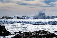 Roaring waves climb then crash.  Pescadero State Beach on the California coast.