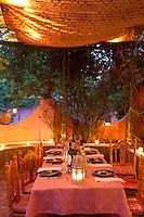 The canopied terrace lit with candles makes an atmospheric place for dinner