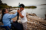 Chantho Suon, left, and her son Adam Di, 8, relax along south of Rio Vista, Calif., June 3, 2011