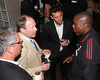 Clarence Seedorf of AC Milan talks to Dave Kasper, Kevin Payne and Ben Olsen of DC United at a reception for AC Milan at DAR Constitution Hall in Washington DC on May 24 2010.