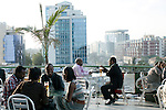ADDIS ABABA, ETHIOPIA - NOVEMBER 16: People have drinks at a popular rooftop cafe on November 16, 2010 in the Friendship shopping mall in Addis Ababa, Ethiopia. Some people can afford to buy expensive locally  and imported cloths despite that this one of Africa's poorest countries. (Photo by Per-Anders Pettersson)