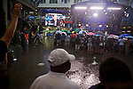 Spectators brave the rain wwaiting to watch a live taping of Hardball with Chris Matthews at the MSNBC EpiCenter during the 2012 Democratic National Convention on Monday, September 3, 2012 in Charlotte, NC.