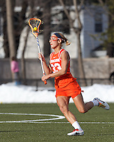 Syracuse University defender Becca Block (33) looks to pass.  Syracuse University (orange) defeated Boston College (white), 17-12, on the Newton Campus Lacrosse Field at Boston College, on March 27, 2013.