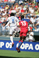 Walter Martinez (13) heads the ball over Pierre Richard Bruny (13). Honduras defeated Haiti 1-0 during the First Round of the 2009 CONCACAF Gold Cup at Qwest Field in Seattle, Washington on July 4, 2009.