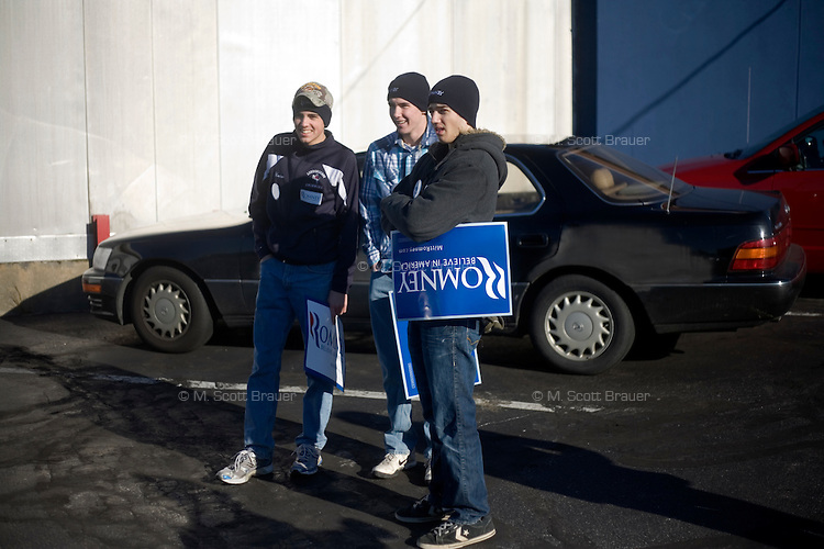 Young Romney supporters stand in a parking lot after a rally for Republican presidential candidate Mitt Romney , former governor of Massachusetts, in Manchester, New Hampshire, on Sat. Dec. 3, 2011. The rally was called, &quot;Earn It with Mitt,&quot; and was designed to bolster local efforts to help Romney &quot;earn&quot; voters' support for the upcoming Republican primary.