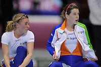 SCHAATSEN: HEERENVEEN: Thialf, Essent ISU World Single Distances Championships 2012, 3000m Ladies, Linda de Vries (NED) en Ireen Wüst (NED) na afloop van hun rit, ©foto Martin de Jong