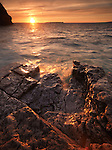 Rocks on the shore of Georgian Bay, beautiful sunset nature scenery in golden colors. Bruce Peninsula National Park, Ontario, Canada.