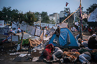 In this Saturday, Jun. 08, 2013 photo, protesters sleep as dawn rises up in Gazi park of Taksim Square during a 24/7 masive rally against the turkish government in Istanbul, Turkey. (Photo/Narciso Contreras).