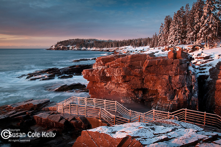 A winter sunrise on the rocky coast of Maine at Thunder Hole, Acadia National Park, ME, USA