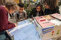 A resident of city Council District 3, left, in New York casts her ballot in participatory budgeting on Sunday, April 2, 2017. Voters residing in some of the City Council districts that are participating can choose projects to receive the largesse of each district's $1 million capital budget. (© Richard B. Levine)