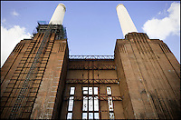 Battersea Power Station, London, UK, showing the exterior of the building and two of the iconic chimneys.