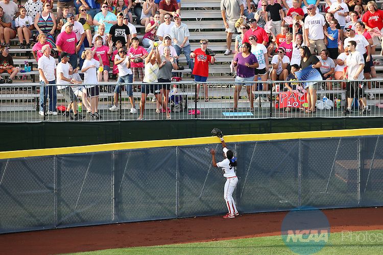 08 JUNE 2010:  Brittany Lastrapes (35) of the University of Arizona watches as fans catch a home run ball during the Division I Women's Softball Championship at ASA Hall of Fame Stadium in Oklahoma City, OK.  UCLA defeated Arizona 15-9 to win the national title.  Stephen Pingry/ NCAA Photos