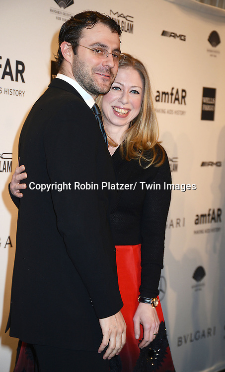Chelsea Clinton and husband Marc Mezvinsky attend the amfAR New York Gala on February 5, 2014 at Cipriani Wall Street in New York City.