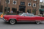 March 31, 2013 - Garden City, New York, U.S. - The driver is wearing Easter Bunny ears in this Holiday Red Oldsmobile Ninety Eight Convertible in the 58th Annual Easter Sunday Vintage Car Parade and Show sponsored by the Garden City Chamber of Commerce. Hundreds of authentic old motorcars, 1898-1988, including antiques, classic, and special interest participated in the parade.