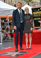 Actor Ryan Reynolds &amp; actress Anna Faris at the Hollywood Walk of Fame Star Ceremony honoring actor Ryan Reynolds.<br /> Los Angeles, CA. <br /> December 15, 2016<br /> Picture: Paul Smith/Featureflash/SilverHub 0208 004 5359/ 07711 972644 Editors@silverhubmedia.com
