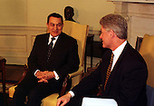 President Hosni Mubarak of Egypt meets United States President Bill Clinton in the Oval Office of the White House in Washington, D.C. on Monday, March 10, 1997..Credit: Ron Sachs / CNP