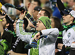 Seattle Sounders fans cheer on the Sounders in their game agsinst the Portland Timbers during an MLS match on April 26, 2015 at CenturyLink Field in Seattle, Washington.  Seattle Sounders Clint Dempsey scored a goal to give the Sounders a 1-0 victory over the Timbers. Jim Bryant Photo. ©2015. All Rights Reserved.