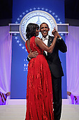 United States President Barack Obama and first lady Michelle Obama dance together during the Inaugural Ball at the Walter Washington Convention Center January 21, 2013 in Washington, DC. President Obama started his second term by taking the Oath of Office earlier in the day during a ceremony on the West Front of the U.S. Capitol. .Credit: Chip Somodevilla / Pool via CNP