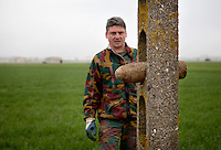 Nearly 100 years after First World War (WWI) Dirk Van Parijs, team leader with the Belgian Unexploded Ordnance Disposal Group continues to collect ploughed up WW1 munitions from farms in the Ypres area. Many are left by farmers in telegraph poles at the side of the road. Some are high explosive and some contain poison gas.