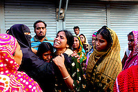 Women cry in front of the collapsed Rana Plaza complex in Savar near Dhaka. The 8 storey building, which housed a number of garment factories employing over 3,000 workers, collapsed on 24 April 2013. By 29 April, at least 380 were known to have died while hundreds remained missing. Workers who were worried about going to work in the building when they noticed cracks in the walls were told not to worry by the building's owner, Mohammed Sohel Rana, who is a member of the ruling Awami League's youth front. He fled his home and tried to escape to neighbouring India after the building collapsed but was caught by police and brought back to Dhaka. Some of the factories working in the Rana Plaza building produce cheap clothes for various European retailers including Primark in the UK and Mango, a Spanish label. . /Felix Features