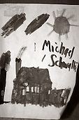 "A close up of a picture on Sunday December 4, 2005 Michael Schwallie's drew when he was 41 years old. Michael now 43 and autistic, lives at the Sobolevitch House in Robbinsville, NJ.,  one of Eden's first group homes and has been home to Michael for more then 20 years. Autism was relatively not known at the time Michael was diagnosed around the age of 4 1/2. In fact, his pediatrician in Cleveland, Ohio accused Michael's parents for ""creating an angry child"" and giving no ""consistency"" in the parenting of young Michael. Michael who has 5 other siblings, has a younger brother with Asperger's syndrome which is similar to autism Autism is on the rise in America and it is estimated that 1.5 million Americans are afflicted with the neurological disorder. There is no known cure for autism nor no known origin. Those families afflicted with the disease, have a greater chance of having a child with some form of autism. This includes the siblings offspring as well. photo by jane therese"