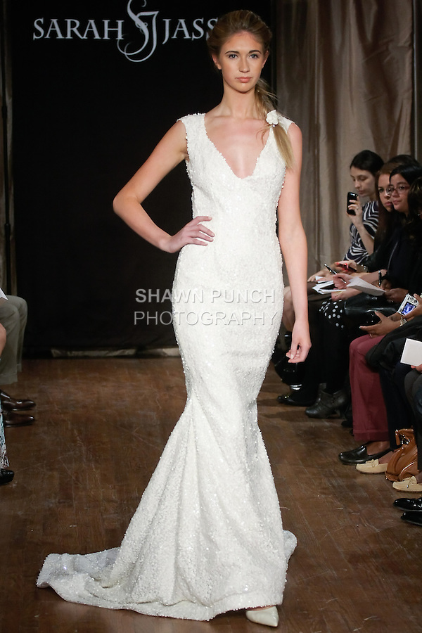 "Model walks runway in a Celine Bridal dress - sequin beaded gown with a deep V-neck and keyhole back, by Sarah Jassir, for the Sarah Jassir Spring 2013 ""La Reve: The Dream"" collection, during Bridal Fashion Week New York."